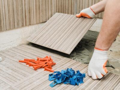 man-doing-installation-ceramic-tiles_191163-1125